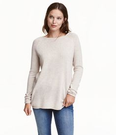 Light beige melange. Fine-knit sweater with wool content. Long raglan sleeves and rolled raw edges. Rounded hem, slightly longer at back.