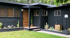 Exterior: Plants  Sculptural, drought-tolerant greenery was the ideal counterpoint to the house's dark finish. We went with cactus to continue the midcentury look, Michael says. Pea gravel tops the previous mulch-and-dirt mixture.