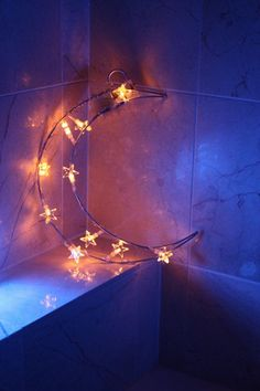 A whimsical moon light to hang as a centerpiece to your canopy.