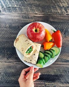hummus, cheese and veggie wrap with cucumbers, sweet mini peppers and an apple for lunch.