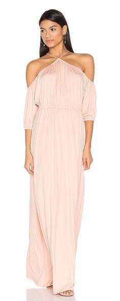 Zia Dress by Rachel Pally. 92% modal 9% elastane. Dry clean recommended. Unlined. Elastic empire waist. Neckline tie detail. Raw cut hem. Jersey...