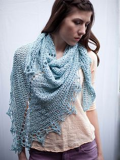 Feminine and light weight, this triangle lace shawl features eyelets down the center and beautiful lace edging.