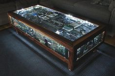 Glass coffee table illuminates recycled computer boards with LED lights, from EcoFriend.