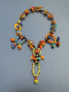 Necklace by Gretchen Schueller of Piece of Mind, gorgeous lampwork beads by Sharon Peters