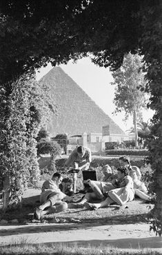EGYPT. British forces relax in the ground of the Mena House Hotel by the Pyramid of Cheops near Cairo. 1941.