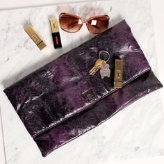 ✨Oversized Purple Embossed Python Clutch✨ Oversized Purple Embossed Python Clutch - magnetic closure - inside zip pocket and two cell phone pockets. This clutch is so soft and it can be used not only as a clutch, but as a travel makeup bag if it's unfolded. Used once. Sondra Roberts Bags Clutches & Wristlets