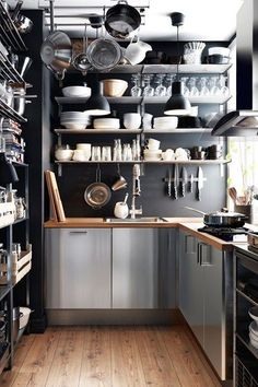 Explore our kitchen design ideas, including these sleek and industrial kitchen cabinets Industrial Kitchen Design, Industrial Interiors, Kitchen Interior, Kitchen Decor, Kitchen Ideas, Industrial Style, Industrial Office, Kitchen Supplies, Industrial Kitchens