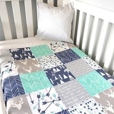 The perfect patchwork quilt, made with love just for your little love! This adorable quilt is perfect for that special little person in your life. Black and white with a splash of mint make this a charming monochrome quilt! ~ Measures approximately 100 x 120 cm. Great for all cot sizes,