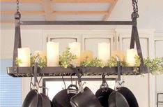 This hanging pot rack will turn your pots, pans and serving boards into an artful display while keeping them within easy reach. The industrial look and functional design will fill your kitchen with character and the storage you need. Hanging Pans, Pot Rack Hanging, Industrial Pot Racks, Industrial Metal, Home Decor Kitchen, Kitchen Design, Apartment Kitchen, Kitchen Ideas, Tuscan Decorating