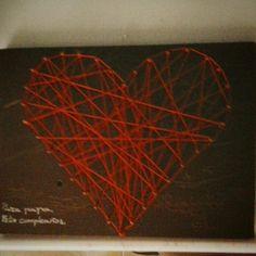Corazón de tela en madera