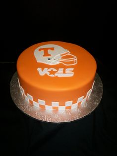 This was Jason's groom's cake! :)...For your Tennessee Fan- inside was an orange and white checkerboard cake!