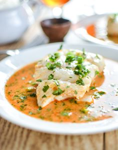 Poached Halibut in Tomato Curry Broth -- is a simple weeknight dinner recipe that the entire family can enjoy! | www.cookingandbeer.com