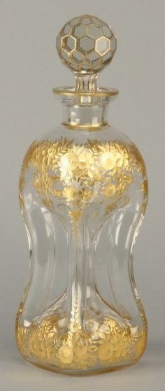 Moser art glass decanter Late century Moser art glass decanter with wheel cut gold gilt floral designs, x square base.Late century Moser art glass decanter with wheel cut gold gilt floral designs, x square base. Perfumes Vintage, Antique Perfume Bottles, Vintage Perfume Bottles, Bottle Vase, Bottles And Jars, Glass Bottles, Beautiful Perfume, Antique Glass, Vases