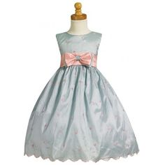 Style: LM559 Colors: Light Blue/Pink Sleeveless embroidered taffeta polka-dot bodice Contrasting waistband Button closure Removable bowtie Crinoline slip attach