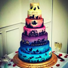 the idea of favorite Disney movies on each layer! Love the idea of favorite Disney movies on each layer! Love the idea of favorite Disney movies on each layer! Love the idea of favorite Disney movies on each layer! Disney Desserts, Cute Desserts, Crazy Cakes, Fancy Cakes, Cute Cakes, Beautiful Cakes, Amazing Cakes, Gateau Harry Potter, Funny Wedding Cakes