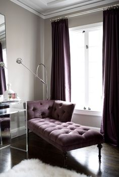 Example of colors/hues.    Purple wall of curtains behind bed and 3 gray walls.