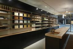Aesop's first shop in Seoul features recycled pine and blackened-steel fittings.