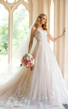 Holy shit. Soft blush tulle wedding dress with white embroidery and a sweetheart neckline