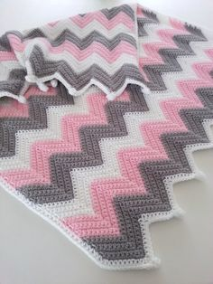 ❤READY TO SHIP❤ This blanket is done in soft worsted weight acrylic yarn in baby pink, white, and gray. Its done in a single crochet ripple stitch and measures 30 x 34. This would be a fantastic shower gift! New moms and babies LOVE handmade blankets. Its completely machine washable so its easy care for mom, too! I ship using USPS Priority Mail from North Carolina. All items in my shop are handmade by me personally in my smoke free home. They are not pre-washed and contain no perfume...