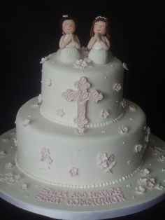 First Communion cake I made for 2 little cousins..I modeled the girls freehand, used a mold for the cross..everything edible