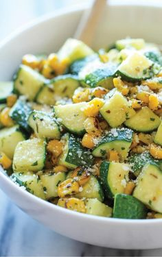 Parmesan Zucchini and Corn Easy vegetable side dish! PARMESAN ZUCCHINI AND CORN = 2 T olive oil 2 cloves garlic 4 zucchinis, diced 1 cup corn kernels, frozen, canned or roasted t dried basil t dried oregano t dried thyme Kosher salt and freshly Easy Vegetable Side Dishes, Vegetable Sides, Veggie Dishes, Vegetable Recipes, Food Dishes, Vegetarian Recipes, Healthy Recipes, Cooking Recipes, Healthy Zucchini Recipes