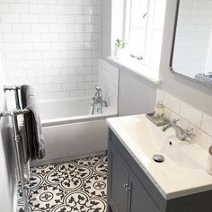 Black and white patterned floor tiles. White metro wall tiles. Photo by @poms_abode