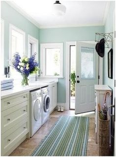 laundry room: love the color and the countertop over the appliances would make a great space to fold clothes