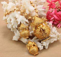 Beautiful pumpkin long chain with kalasa pendant with lakshmi devi pendant. Black Gold Jewelry, Pearl Jewelry, Wedding Jewelry, Antique Jewelry, India Jewelry, Temple Jewellery, Jewelry For Her, Simple Jewelry, Indian Jewellery Design