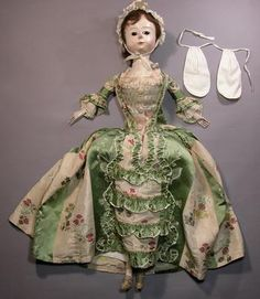 This is one of many beautiful 18th and 19th c. dolls and doll clothes on this website. You must go see the rest!