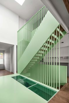 sage green staircase takes center stage in montreal residence renovation by naturehumaine Narrow Balcony, French Balcony, Balcony Deck, Architecture Design, New Staircase, Stair Railing, Railings, Architectural Elements, Skylight
