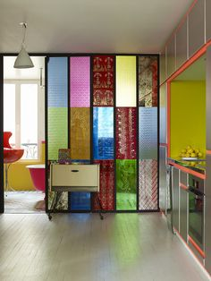 Contemporary Eclectic Modern Wall Treatment: stain less steel–fronted appliances and cabinetry in a colorful Paris kitchen.