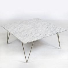Master bedroom sitting area.  Silver Leafed hairpin leg mid century style coffee table with white variegated marble top. Natural color variations are to be expected in marble top.