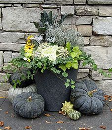 Tasteful, subtle, unique fall décor in greys with just a touch of color.