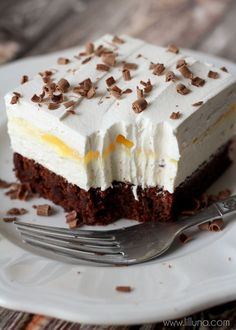 Brownie Delight - a delicious 4-layer dessert that is cool, creamy and chocolate-y. looks so good!