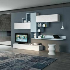 "Contemporary TV unit composition Domino by Favero, features 2 wooden base units, 3 wall mounted units, wall mounted bookcase elements and a wall mounted shelf. image #""tvwallmount"""