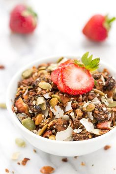 This grain-free coconut granola is the ultimate breakfast treat! It's crunchy, sweet and made with all natural, healthy ingredients. Paleo + vegan too!