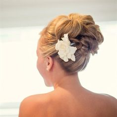 Bridal Updo with Floral Hairpin; I feel like this is what my hair is going to look like if it goes up.