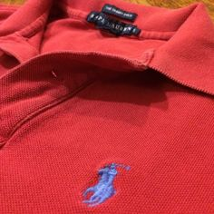 Ralph Lauren skinny polo short sleeve Awesome little preppy/casual top! Nice slightly faded red color. Skinny fit--very flattering and feminine! Ralph Lauren Tops