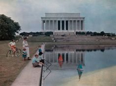 Reflecting Pool, Washington  Photograph by Willard Culver, National Geographic  This Month in Photo of the Day: City Pictures  Children sail toy boats in the Lincoln Memorial Reflecting Pool in this photo originally published in the June 1937 issue of National Geographic. The 2,028-foot rectangular pool, which reflects the Lincoln Memorial at one end and the Washington Monument at the other, is among the most iconic landmarks in Washington, D.C.