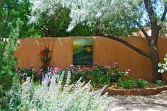 Adobe wall with art