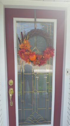 Fall DIY wreath.  With grapevine wreath and dollar store bought fall decor :)