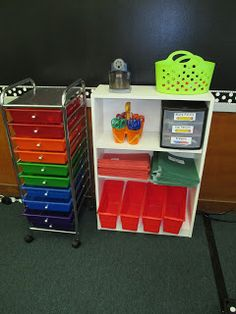 Supply Center- I'll house my Daily 5 materials in the colorful drawers. On the shelf is my pencil sharpener, glue sticks, scissors, pencil drawers, and table supplies will go in the bottom red boxes.