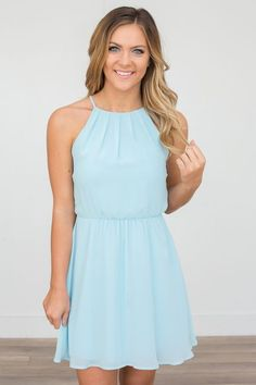 Shop our Sleeveless Open Back Dress -in Aqua. Featuring a button back closure and fully lined. Free shipping on all US orders!