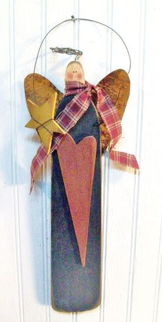 Primitive and Folk-art Style Christmas Angel with a Heart. Vintage from Estate Sale. Metal, Wood, and Cloth. Awesome.. $9.99, via Etsy.