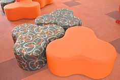 Ottomans custom covered to suit the library's interior design