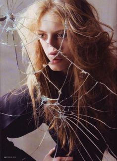 "I stare blankly at the cracked mirror. Why did I break it? Was it even me? A noise behind me grabs my attention. ""Who are you?"" I ask the person behind me."