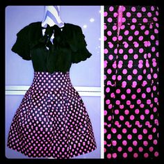 Gorgeous pink polka-dot skirt. NWT Brand new with tags.  This skirt features Rows of black elastic with vibrant pink polka-dots all over. Pair it with a black top, blazer and heels or with a playful white top and booties with a denim jacket.   Zipper detail in back  Stretchy material. Overall length approx 18 inches  80% polyester 20% elastic Size S/M Skirts A-Line or Full