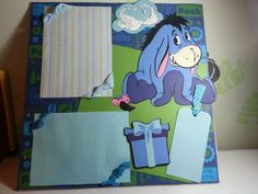 Disney Winnie the Pooh 12x12 chipboard album I made for my daughter's birthday.  Page 10 will hold 2 pictures and has a tag for journaling.  Made by Donna T with♥ for my daughter