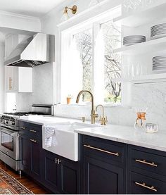 Tonight's kitchen crush! I love the black cabinets, the hardware, the big…