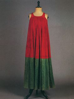 Mórkos: a long, sleeveless, pleated red dress with green satin hem  H. 1.26 m.  Skopelos, Sporades. Early 20th century  © Peloponnesian Folklore Foundation, Nafplion Greece